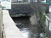Flows beneath Bridge Street