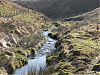 Flowing below Hoccombe Hill